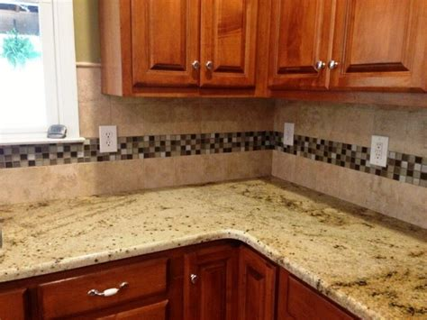 beige granite on medium colored wood cabinets 4 9