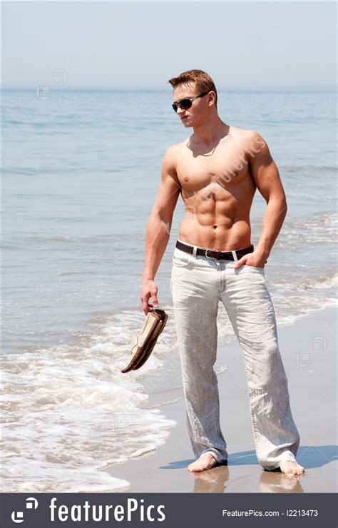 Picture Of Handsome Man Standing On Beach
