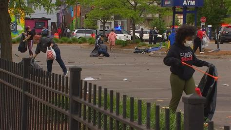 residents  north minneapolis unite  clean  damage