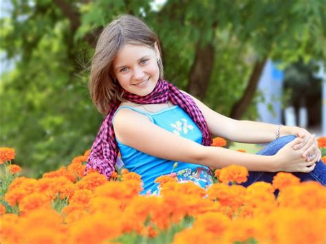 Cute Girl Sitting In Garden Hd Wallpaper #7649