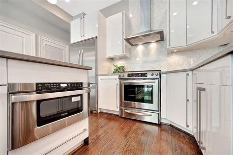 white glossy kitchen cabinets sleek modern who needs