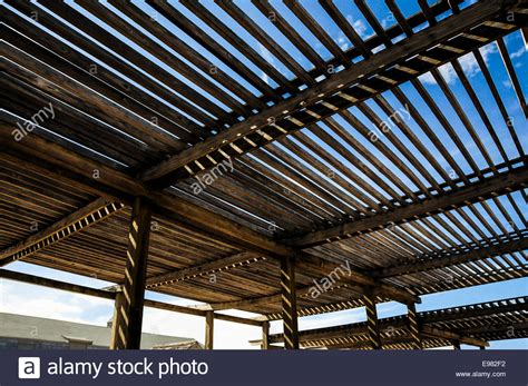 roof slats large wooden slat roof over a patio area with sunlight and blue sky 74550982 alamy