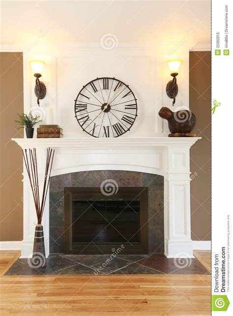 luxury home white fireplace  stone  clock stock
