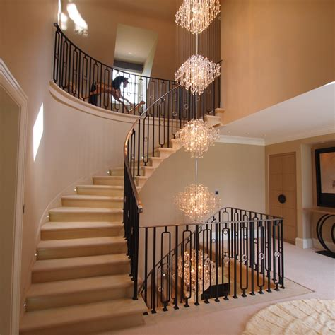 elegant foyer chandeliers mode south east traditional staircase remodeling ideas  banister