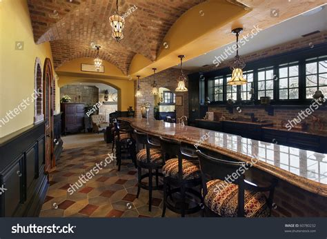 Elegant Basement Bar And Stools In Luxury Home Stock Photo