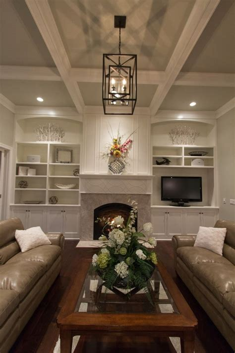 great room  box beam ceiling  cabinets flanking