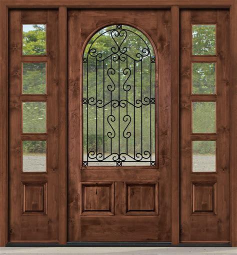 rustic entry door  wrought iron  glass