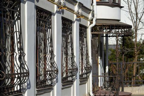 metal wrought iron bars  windows  apartment house