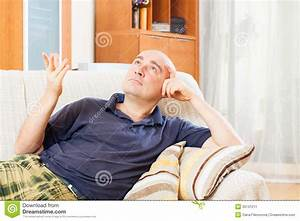 Man Sitting On Couch Stock Image - Image: 35131211