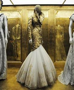 Visitors to Alexander McQueen's 'Savage Beauty' exhibit ...