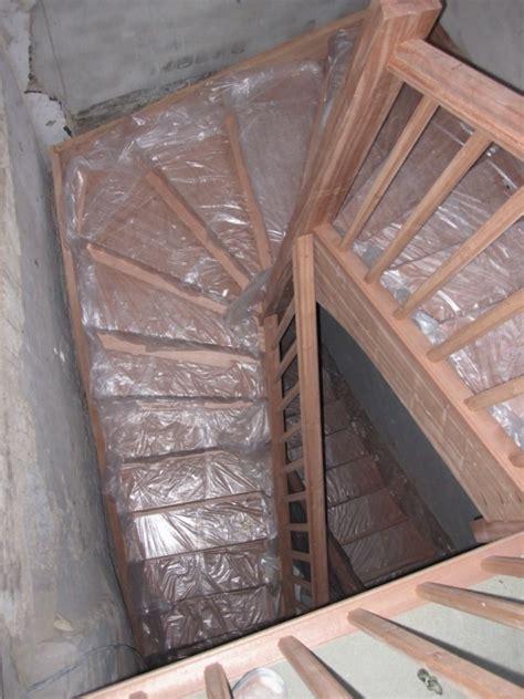escalier bois  tournant pour logement collectif