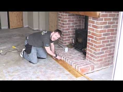 laminate flooring next to fireplace laminatemaster co uk laminate wood flooring undercut stone brick fireplace wall youtube