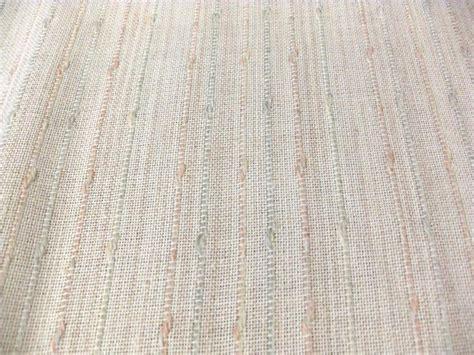 soft muted boucle stripe on peachy ecru open weave drapery