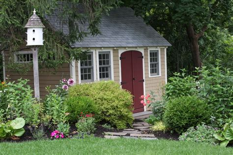 landscaping around a garden shed tuscan delight traditional garage and shed boston by amy martin landscape design