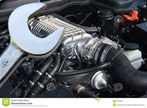 V8 Supercharged Car Engine And Spanner Stock Photo