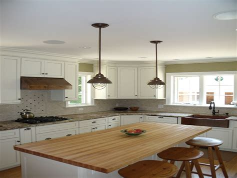 Industrial Pendant Lighting Over Small Kitchen Island With