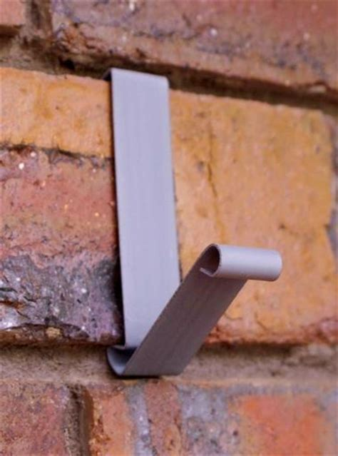 coat hooks brick walls and household items on pinterest