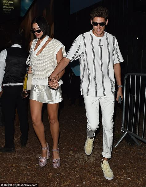 Dua Lipa holds hands with smiling Isaac Carew on way home ...