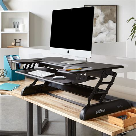 adjustable desks for standing or sitting uk height adjustable standing desks varidesk sit to stand desks