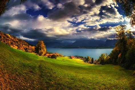 wallpaper switzerland oberhofen nature autumn sky lake meadow