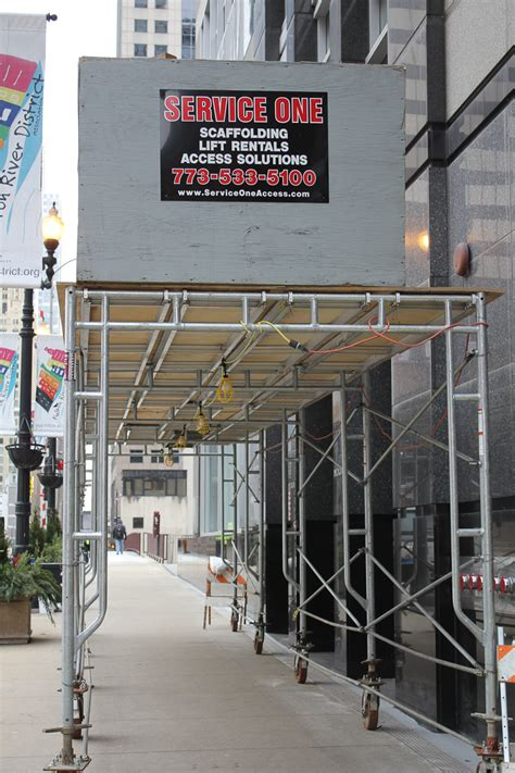 sidewalk canopies overhead protection glass metal