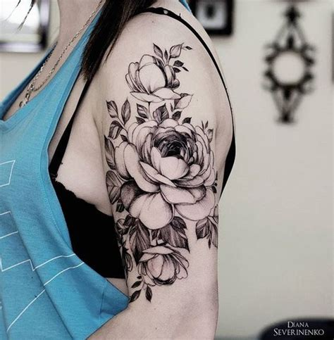 picture  black flower arm tattoo
