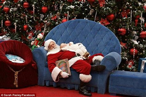santa s baby adorable picture of mall santa lulling a fussy newborn back to sleep daily mail