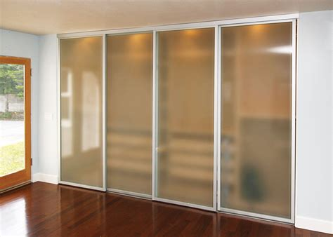 Sliding Glass Cupboard Doors by Frosted Glass Sliding Closet Doors With Silver Frame