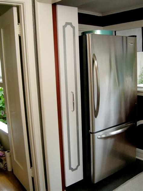 vertical kitchen storage how to build a vertical pull out cabinet hgtv 3129