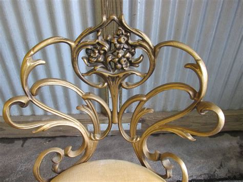 pair of cast iron regency chairs for sale at 1stdibs