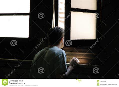 Man Looking Through Window Stock Photos