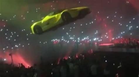 yellow ferrari floated  crowd  drakes show