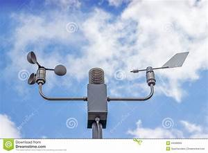 Anemometer And Wind Vane On Blue Sky Stock Photo