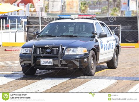 A Police Car Parked In Front Of The White House In
