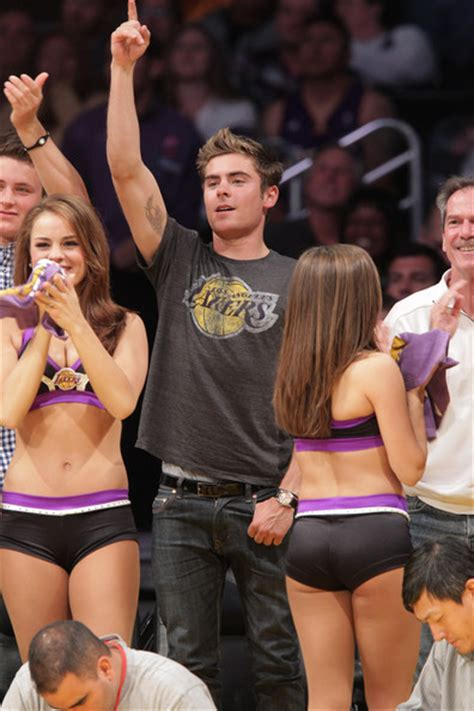 zac efron poses  brother  naked laker girls