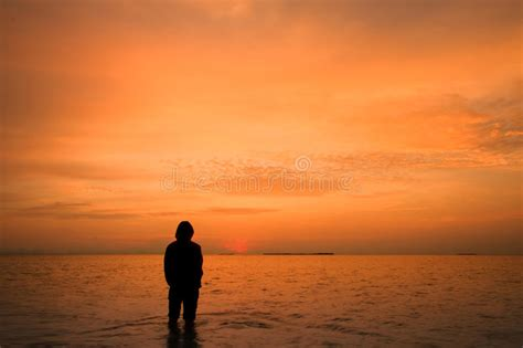 Lonely man in sunrise stock image. Image of morning, tide ...