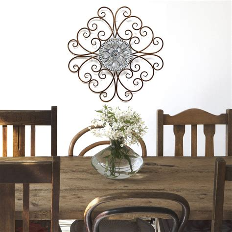 The antique flower wall sculpture from stratton home decor puts a rustic spin on the traditional flower. Stratton Home Décor Scroll Medallion Wall Décor - Stratton Home Decor