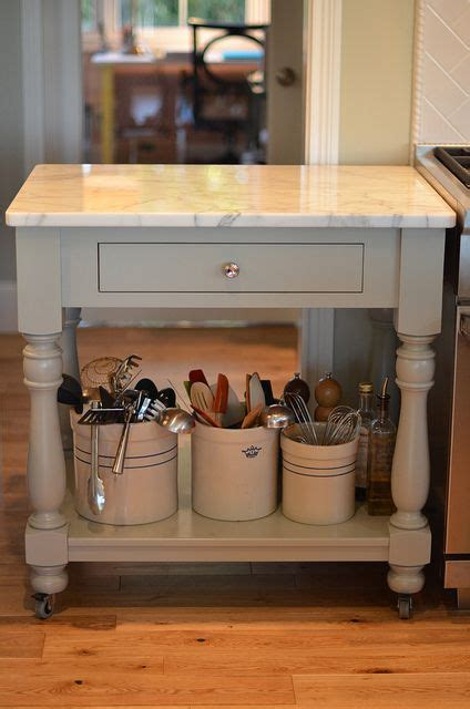 how to redo kitchen cabinets on a budget best 25 rolling kitchen island ideas on 9821
