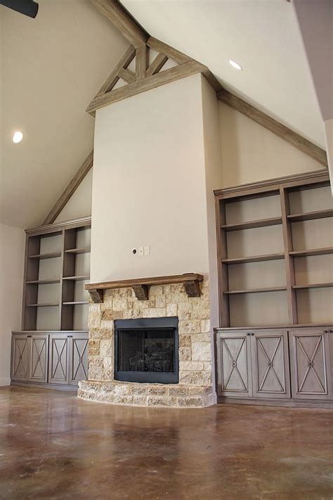 faux painted built  cabinetry vaulted ceiling beams
