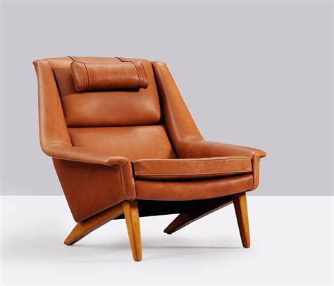 reupholstered lounge chair in cognac leather for