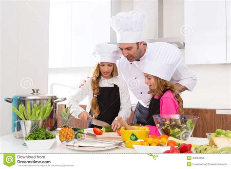 cuisine cook master chef master and junior pupil kid at cooking royalty free stock photo