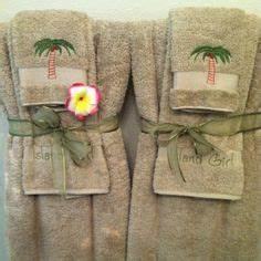 1000 images about decorative towels on pinterest for How to tie towels in bathroom