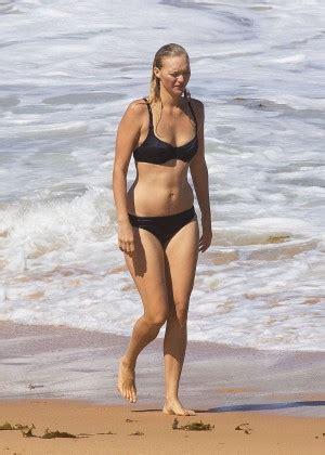 lisa kudrow bikini gemma ward black bikini candids at a beach in sydney
