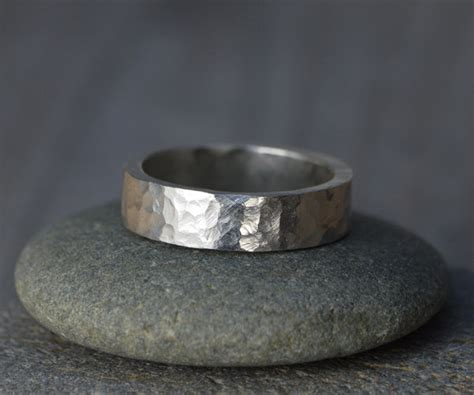hammered effect wedding band in sterling silver with