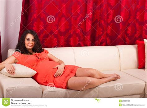 One Person Sofa by Pregnant Woman Lying On Couch Royalty Free Stock Photos