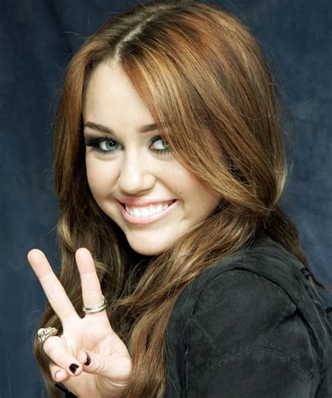 miley cyrus casual long wavy hairstyle light brunette