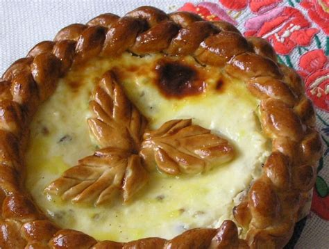 This spiced fruit and nut bread topped with egg meringue and almonds will set your mood correct for the party. Romanian Easter Bread with Cheese Recipe - Pasca