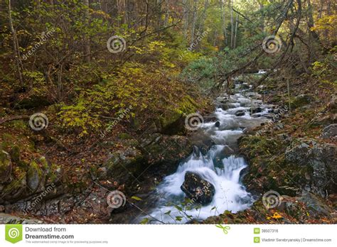 Autumn Landscape With A Waterfall On The Creek Taiga
