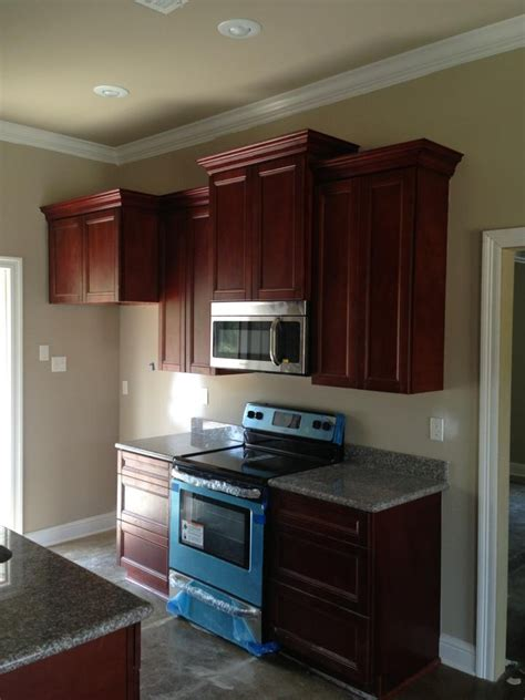 cherry cabinets with gray countertops kitchen walls warm tan grey will lighten the room but