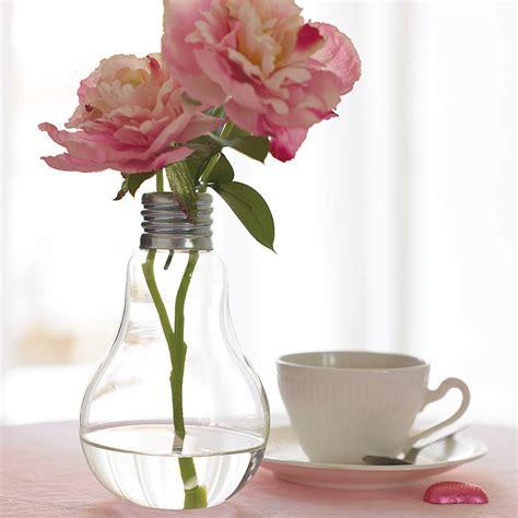 flowers in light bulbs lightbulb vase by london garden trading